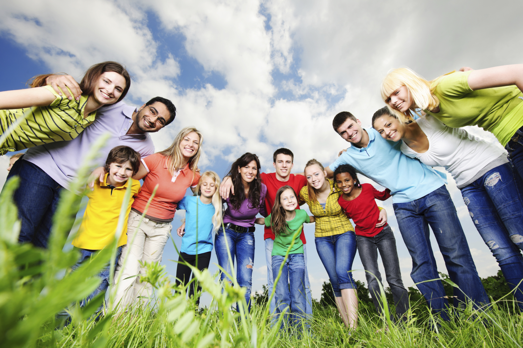 Large embraced young group of people are standing in the nature and looking at the camera.   [url=http://www.istockphoto.com/search/lightbox/9786738][img]http://img830.imageshack.us/img830/1561/groupsk.jpg[/img][/url]